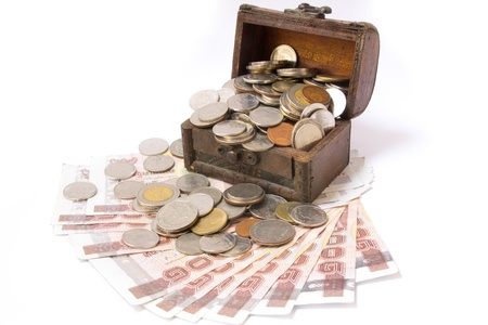 Wooden chest of money, isolated over white background photo