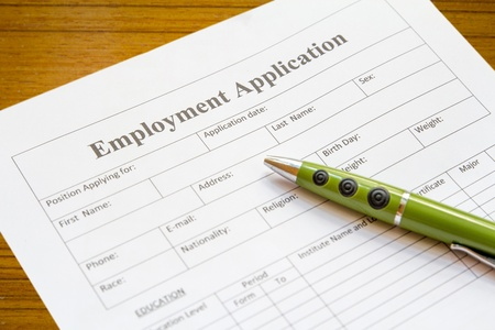 applicant: pen lying on the form of employment