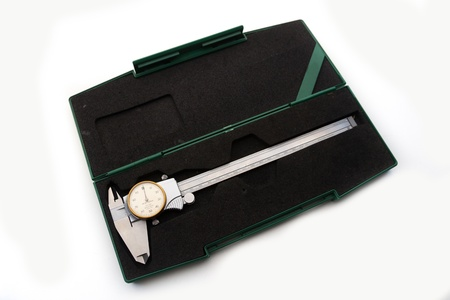 verniercaliper type dial on green box on white background photo