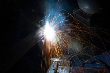 Welder with sparks arcing  photo