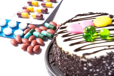 chocolate cake and many medicine on white background