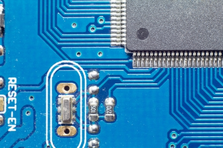 Microchips  by other elements on a circuit board photo