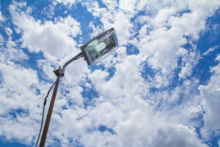 street light pole with a blue sky background photo