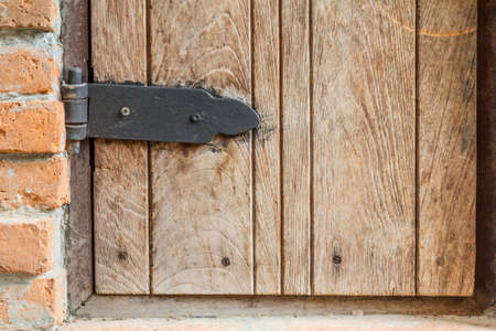 hasp: Wooden wall with doors locked.