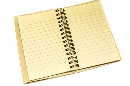 Spiral notebook on white background photo