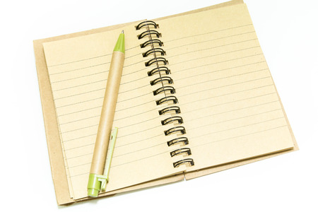 Spiral notebook and pen on white background photo