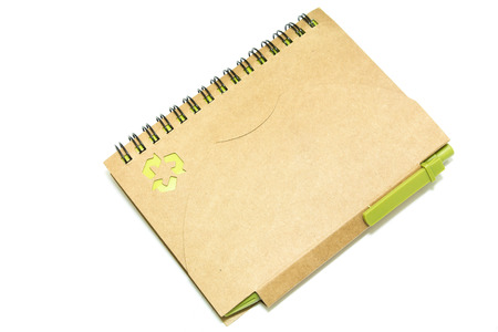 recycle notebook and a pen on white background photo