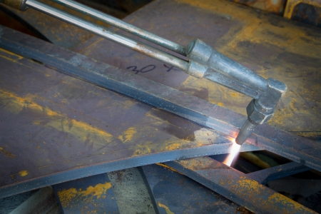 metal cutting with acetylene torch, industrial background Stock Photo