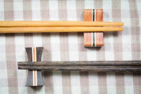 wooden chopsticks on a fabric photo