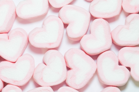 pink Marshmallows of heart shape, on white backgrounds