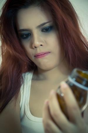 Pills in womens hands in strain concept.