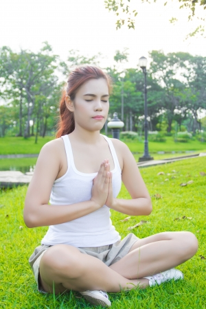 Yoga. asian Young woman doing yoga exercise outdoor photo