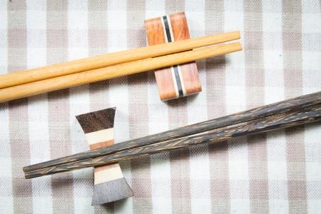 wooden chopsticks on a fabric photo