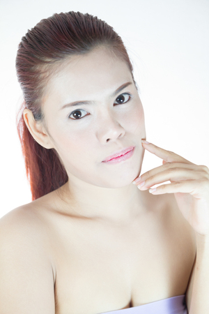 Portrait of a beautiful asian female model on white background photo