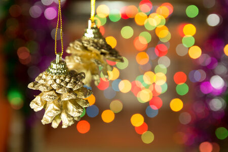 Christmas Pine cones on the Christmas light backgrounds photo