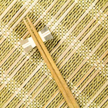 wooden chopsticks on a Bamboo mat photo