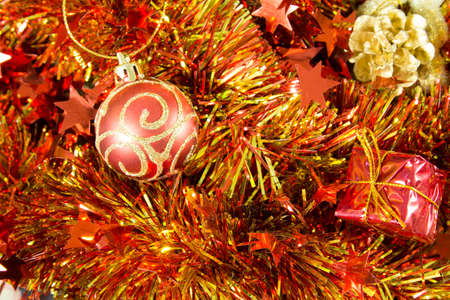 bl: Christmas ball decoration against red ribbon backgrounds.