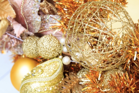 beautify: Christmas flower and ball decoration on Christmas gold tree Stock Photo