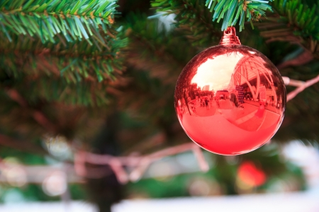 beautify: Christmas ball decoration against lights blurred background Stock Photo