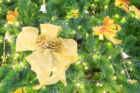 beautify: Christmas gold decoration on Christmas green tree
