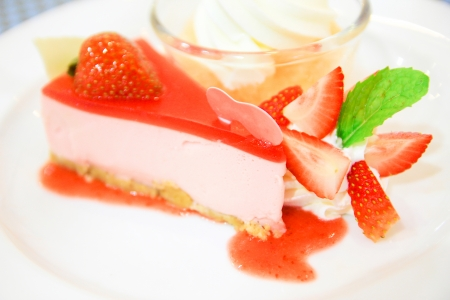 strawberry yogurt cheesecake on white dish, Food background photo