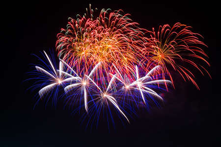Beautiful colorful holiday fireworks on the black sky background, long exposure photo