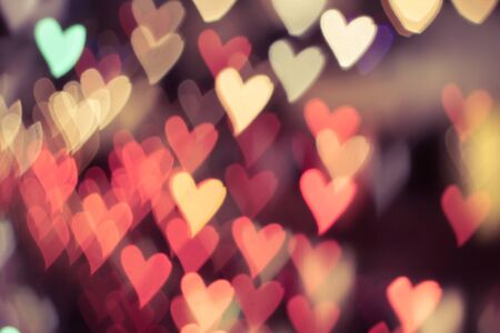 Color Bokeh on a dark background with hearts for use in graphic design photo
