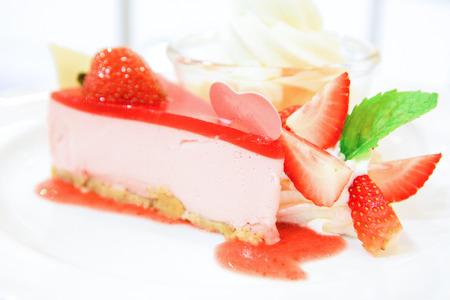 strawberry yogurt cheesecake on white dish, Food background