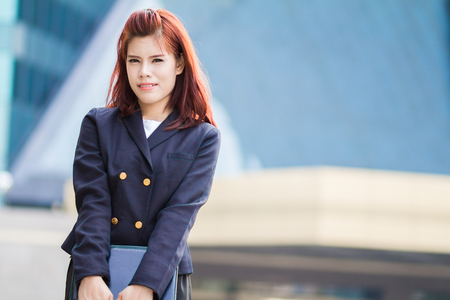asian beautiful Businesswoman holding document file at outdoor office. photo