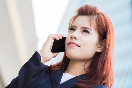 Asian Beautiful businesswoman using a cellular phone photo