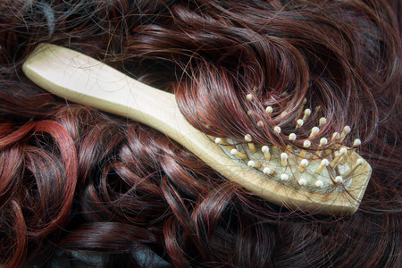 hairbrush with hair background, concept hair loss and healthy Hair photo