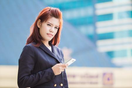 Asian Beautiful businesswoman using a cellular phone photo