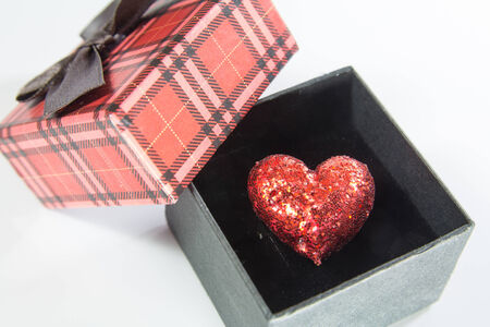 Red velvet Heart-shaped Gift Box with heart on a white background photo