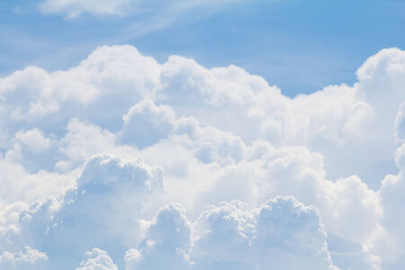 Blue sky background with white clean clouds, nature background photo