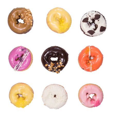 Colorful delicious donuts isolated on white background. photo
