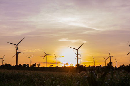 Wind turbine power generator at twilight sunset photo