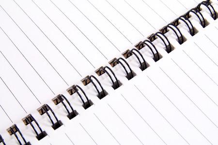 spiral notebook: Extreme closeup of a spiral notebook Stock Photo