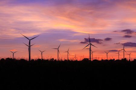 Wind turbine power generator at twilight sunset photo