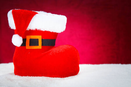 Cute Christmas Boot on red background, concept Christmas photo