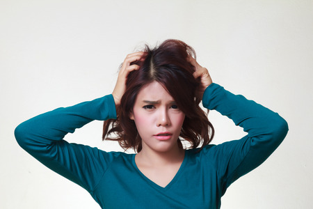 going crazy: Stress. Woman stressed is going crazy pulling her hair in frustration. Stock Photo