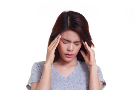holding on head: young woman with a headache holding head Stock Photo