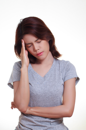 holding the head: young woman with a headache holding head Stock Photo