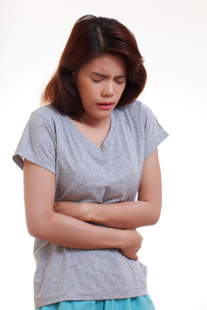 waistline: Woman with both palm around waistline to show pain and injury on belly area and stomach ache. Medical health care concept.
