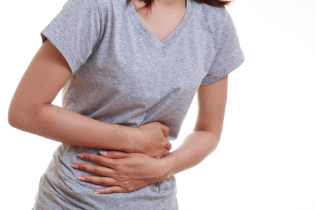 Woman with both palm around waistline to show pain and injury on belly area and stomach ache. Medical health care concept.