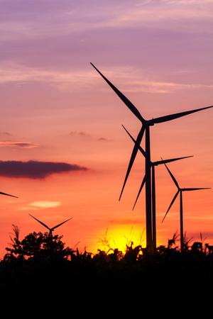 Wind turbine power generator at twilight sunset Imagens
