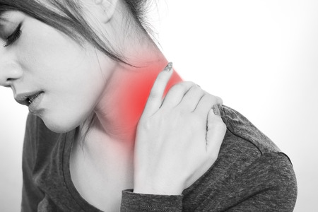 Young woman holding  neck in pain and discomfort photo