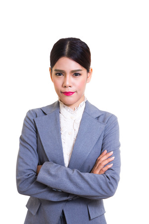 skirt suit: Business woman wearing a skirt suit, standing with confidence.
