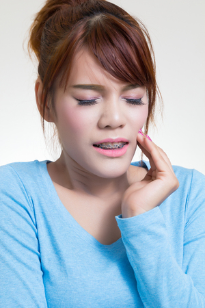 toothache: Beautiful young asian woman suffering from toothache Stock Photo