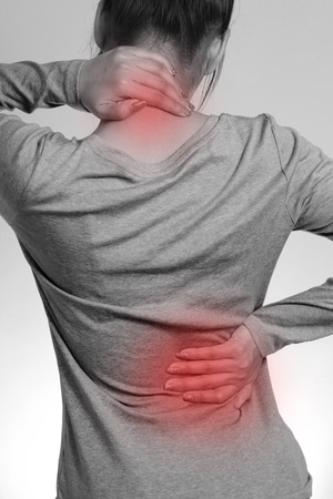 head and  back: Female with pain back pain and neck pain Stock Photo