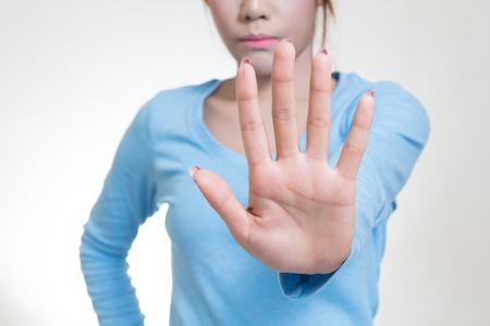 resist: Asian women showing stop hand gesture, selective focus Stock Photo